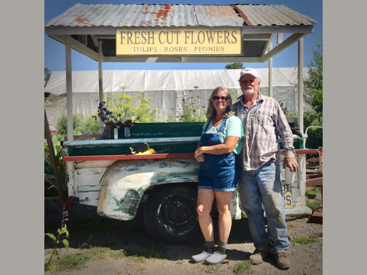 Amy and Jim with the flower cart he built.