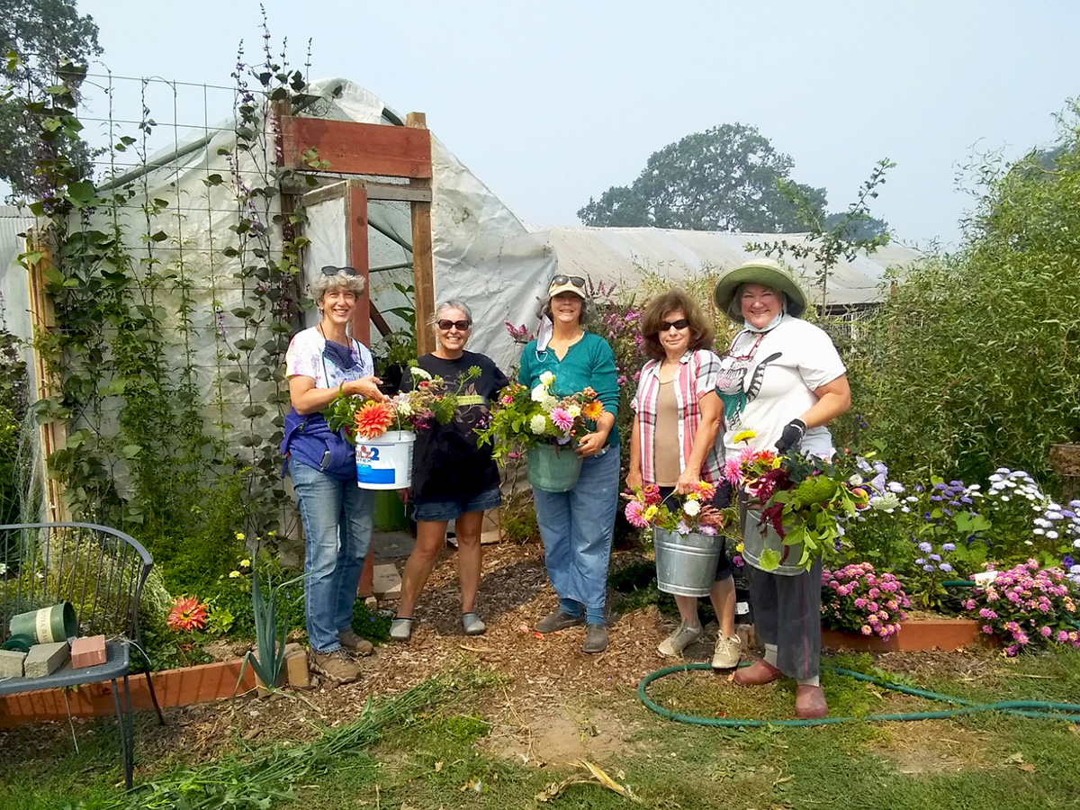 Chris, Amy, Laura Shafer, Deborah Wiig, and Nancy Cadigan with fresh-picked flowers.
