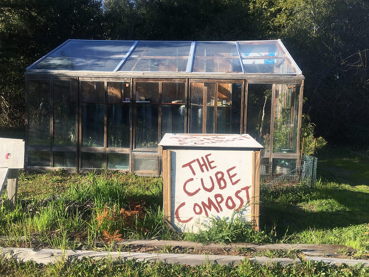 The Allen's solar-powered greenhouse and compost.